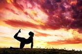 Yoga silhouette parshva marjariasana cat pose — Stock Photo