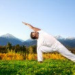 Yoga triangle pose — Stock Photo