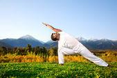 Yoga triangle pose — Stock Photo