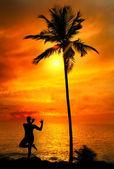 Yoga silhouette lord krishna pose — Stock Photo