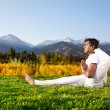Yoga Advance pose in mountains — Stock Photo