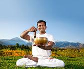Yoga meditation with Tibetan bowl — Stock Photo