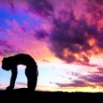Yoga silhouette camel pose — Stock Photo #7431659
