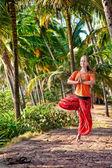 Yoga vrikshasana pose in palm forest — Stock Photo