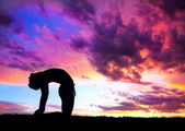 Yoga silhouette camel pose — Stock Photo