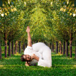 Stock Photo: Yogadvance pose in forest