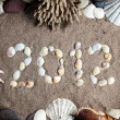 Stock Photo: 2012 year from seashells