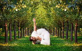 Yoga advance pose in forest — Stock Photo