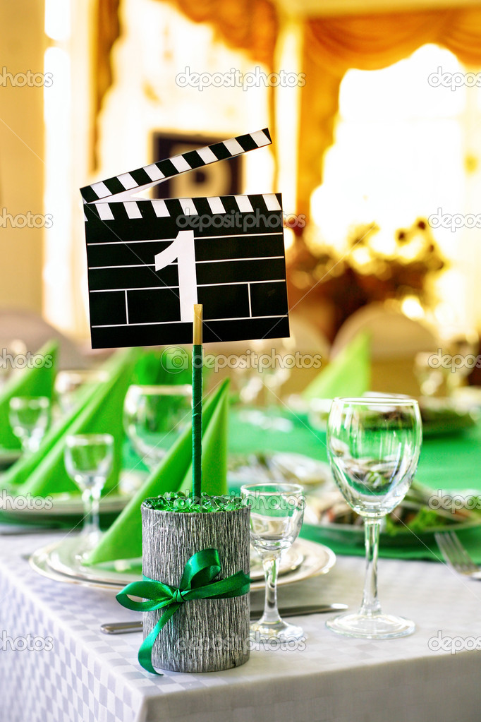 Wedding table served in green colors in movie style with clapboard and number one on it  — Stock Photo #7509236