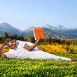 Yoga man reading the book — Stock Photo #7648991