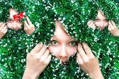 Christmas Girl in tinsel — Stock Photo