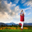 Christmas yoga tree pose — Stock Photo