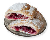 Strudel with apples and cherries — Stock Photo