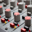 Royalty-Free Stock Photo: Sound mixer console with highlighted button, pump the volume
