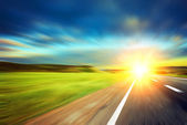 Blurred road and blurred sky with sunset — Stock Photo