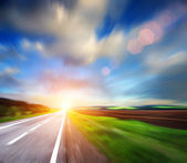 Blured road and blured sky — Stock Photo
