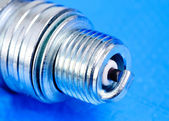 Spark-plug on the blue background — Stock Photo