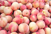 Close-up of juicy ripen peaches as background — Stock Photo