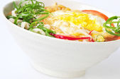 Cooked noodles and fried egg — Stock Photo