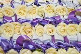 Many white rose with ribbon for holiday — Stock Photo