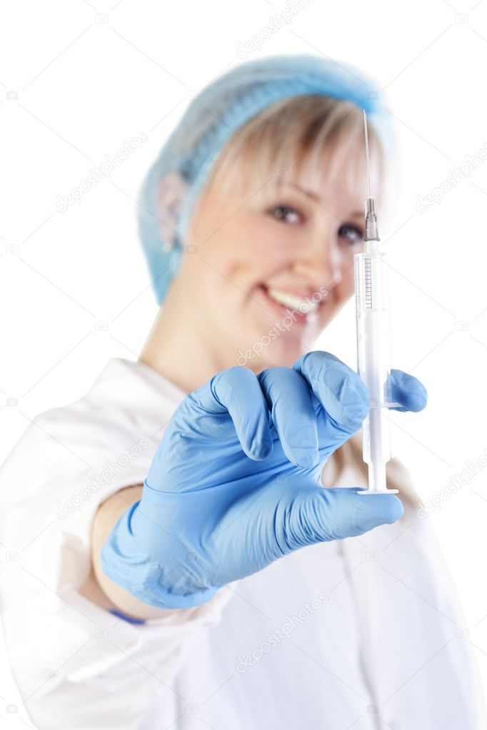 Pretty doctor holding a syringe — Stock Photo #7264533