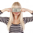 Young woman holding dollar over her eyes — Stock Photo #7323952