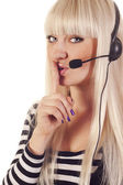 Woman operator with headset saying shh — Stock Photo