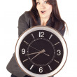 Woman holding clock — Stock Photo #7558305