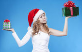 Pretty Santa girl with present gifts for New Year or Christmas — Stock Photo