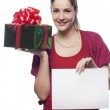 Young woman with present holding empty blank — Stock Photo