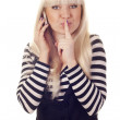 Young womtalking by mobile saying shh — Stock Photo #7561396