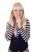 Young woman talking by mobile saying shh — Foto Stock
