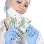 Doctor with money — Stock Photo