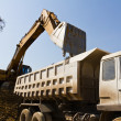 Excavator loader and truck — Stock Photo