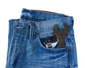 Blue jeans pocket with old tool — Stock Photo