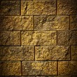 Stock Photo: Dark gold brick wall