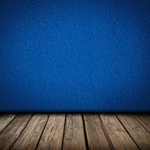 Blue wall and wooden floor interior — Stock Photo