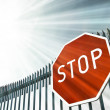Stock Photo: Stop sign on gate