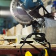 Plywood circular saw and protective earphones — Stock Photo #6837653