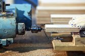 Drilling a plywood at wood factory — Stock Photo