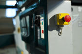 Emergency stop button on industrial saw machine — Stock Photo
