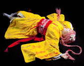 Beauty girl lay in yellow kimono cosplay costume — Foto de Stock