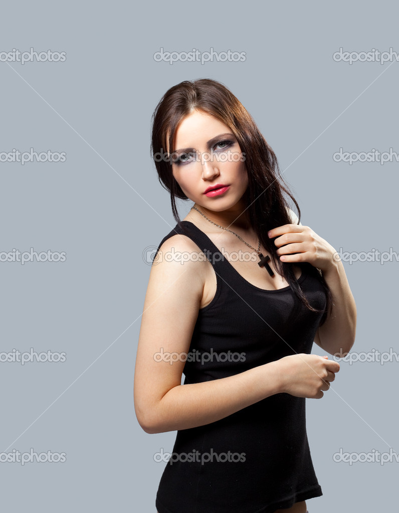 Beauty grunge girl in tank top with cross on breast  Stock Photo #6852673
