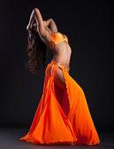 Expressive woman posing in orange arabic costume — Stock Photo