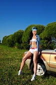 Young sexy woman stay near retro car — Stock Photo