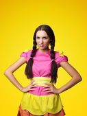 Funny girl in doll costume look serious — Stock Photo