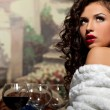 Sexy girl sit with wine in fur coat at evening — Stock Photo #7605504