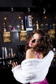 Beauty woman stand near bar in luxury fur — Stock Photo