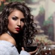 Sexy girl sit with wine in fur coat at evening — Stock Photo #7792187