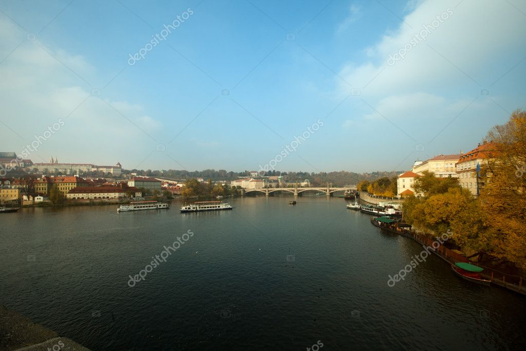Karlov most - Prague historical bridge over vltava river  Stock Photo #7811855